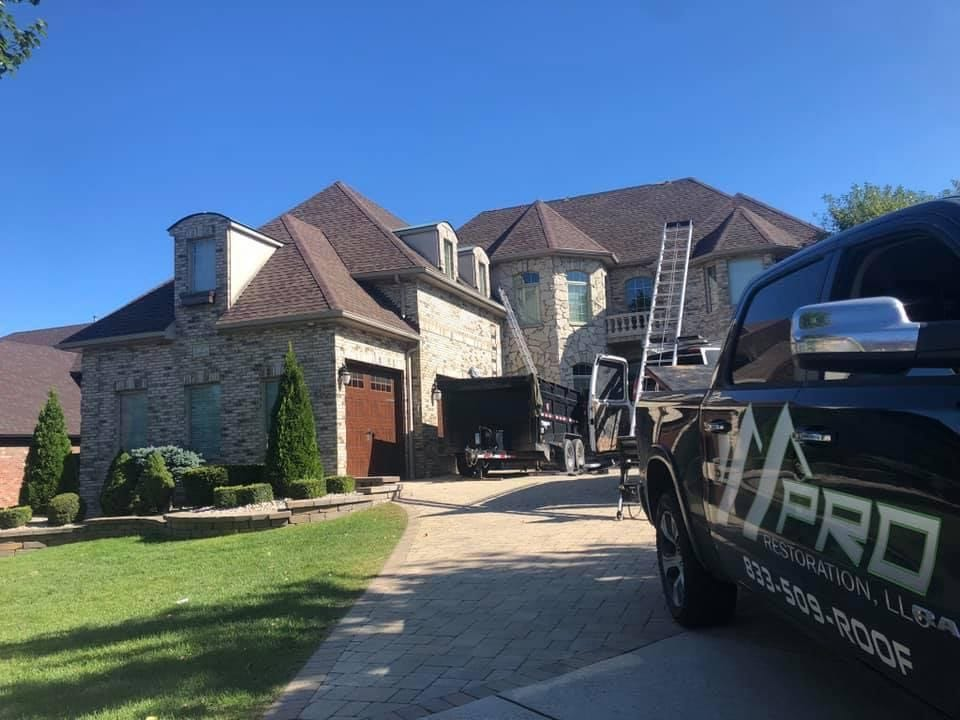 Pro Restoration LLC finishing up a residential roofing job